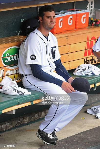 Armando Galarraga of the Detroit Tigers looks on from the dugout during the game against the Cleveland Indians at Comerica Park on June 3 2010 in...