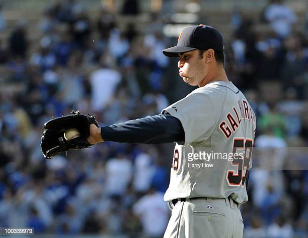 Armando Galarraga of the Detroit Tigers reacts to a homerun by Matt Kemp of the Los Angeles Dodgers during the fifth inning at Dodger Stadium on May...