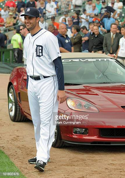 Armando Galarraga of the Detroit Tigers stands in front of his new Chevrolet Corvette awarded to him by Chevrolet for his near perfect game the night...