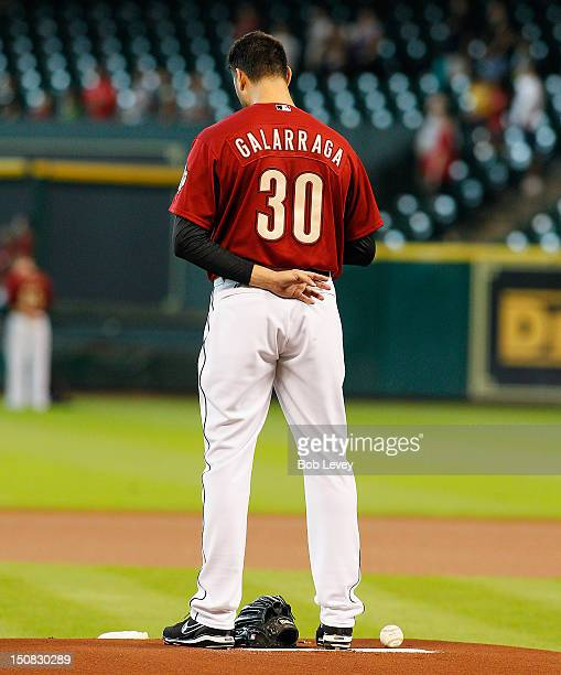 Armando Galarraga of the Houston Astros stands during national anthem at Minute Maid Park on August 19 2012 in Houston Texas