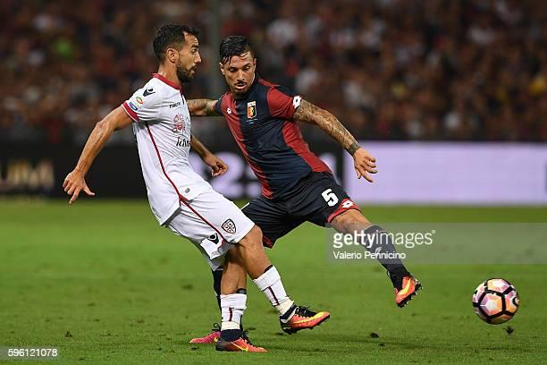 Armando Izzo of Cagliari Calcio competes with Marco Sau of Genoa CFC during the Serie A match between Genoa CFC and Cagliari Calcio at Stadio Luigi...