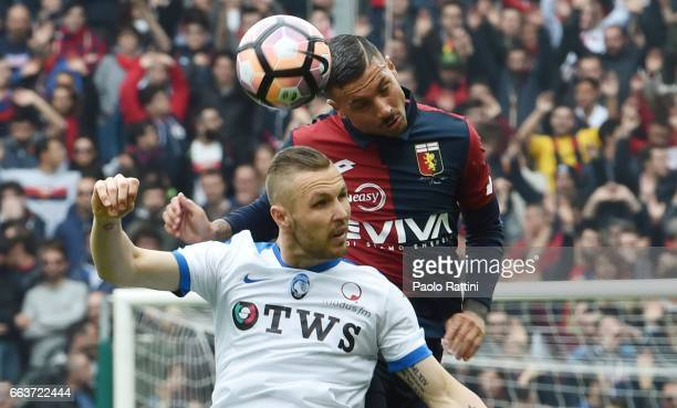 Armando Izzo of Genoa and Jasmin Kurtic of Atalanta during the Serie A match between Genoa CFC and Atalanta BC at Stadio Luigi Ferraris on April 2...