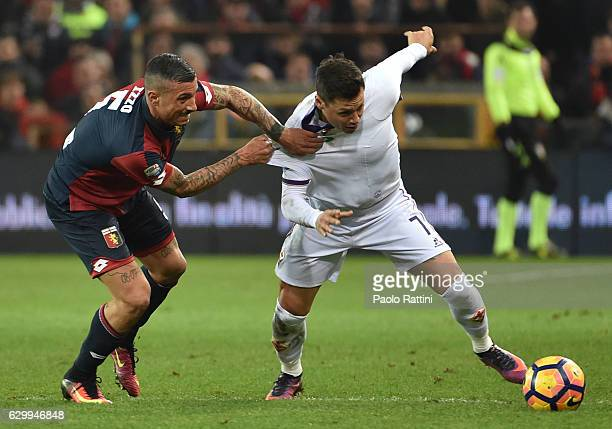 Armando Izzo of Genoa and Mauro Zafate of Fiorentina during the Serie A match between Genoa CFC and ACF Fiorentina at Stadio Luigi Ferraris on...