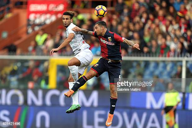 Armando Izzo of Genoa CFC battles for the ball with Kadhim Ali Adnan of Udinese Calcio during the Serie A match between Genoa CFC and Udinese Calcio...