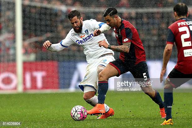 Armando Izzo of Genoa CFC battles for the ball with Levan Mchedlidze of Empoli FC during the Serie A match between Genoa CFC and Empoli FC at Stadio...