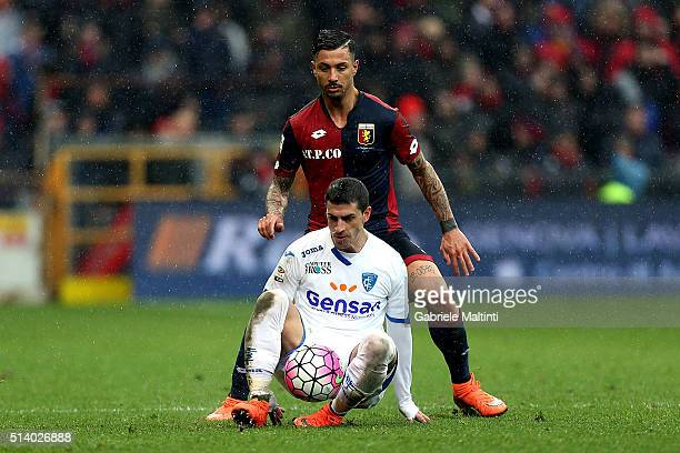 Armando Izzo of Genoa CFC battles for the ball with Manuel Pucciarelli of Empoli FC during the Serie A match between Genoa CFC and Empoli FC at...