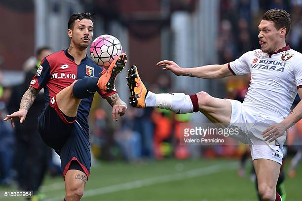 Armando Izzo of Genoa CFC controls the ball against Andrea Belotti of Torino FC during the Serie A match between Genoa CFC and Torino FC at Stadio...