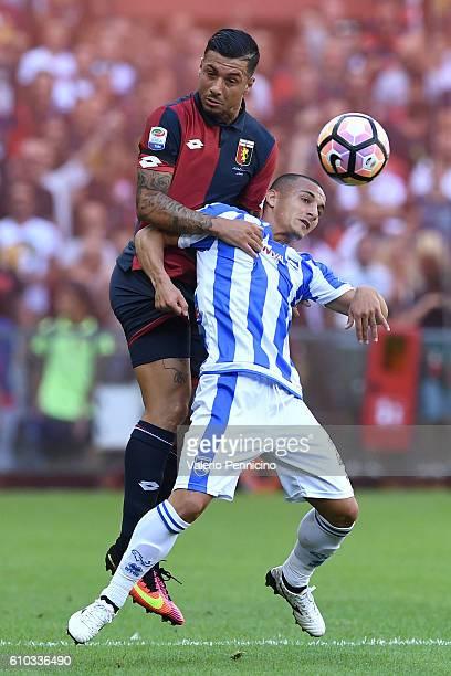 Armando Izzo of Genoa CFC goes up with Alexandru Mitrita of Pescara Calcio during the Serie A match between Genoa CFC and Pescara Calcio at Stadio...