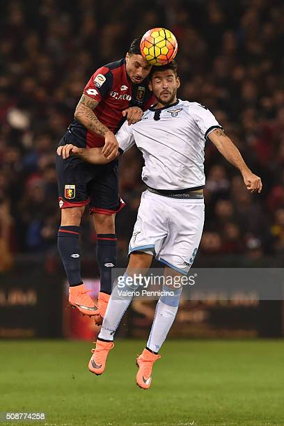 Armando Izzo of Genoa CFC goes up with Filip Djordjevic of SS Lazio during the Serie A match between Genoa CFC and SS Lazio at Stadio Luigi Ferraris...