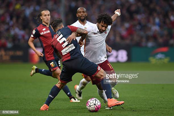 Armando Izzo of Genoa CFC tackles Mohamed Salah of AS Roma during the Serie A match between Genoa CFC and AS Roma at Stadio Luigi Ferraris on May 2...