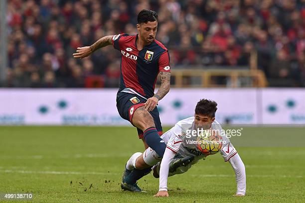 Armando Izzo of Genoa CFC tackles Ryder Matos Santos of Carpi FC during the Serie A match between Genoa CFC and Carpi FC at Stadio Luigi Ferraris on...