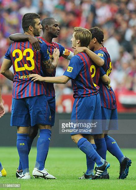 Armando Lozano of Barcelona celebrates with teammates after winning their Audi Cup football match FC Barcelona vs SC International de Porto Alegre in...