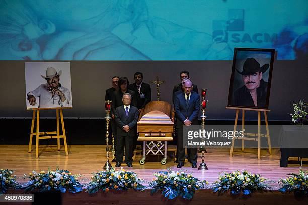 Armando Manzanero songwriter and Roberto Cantoral Zucchi Director of Sociedad Mexicana de Autores stand guard by the coffin of Joan Sebastian during...
