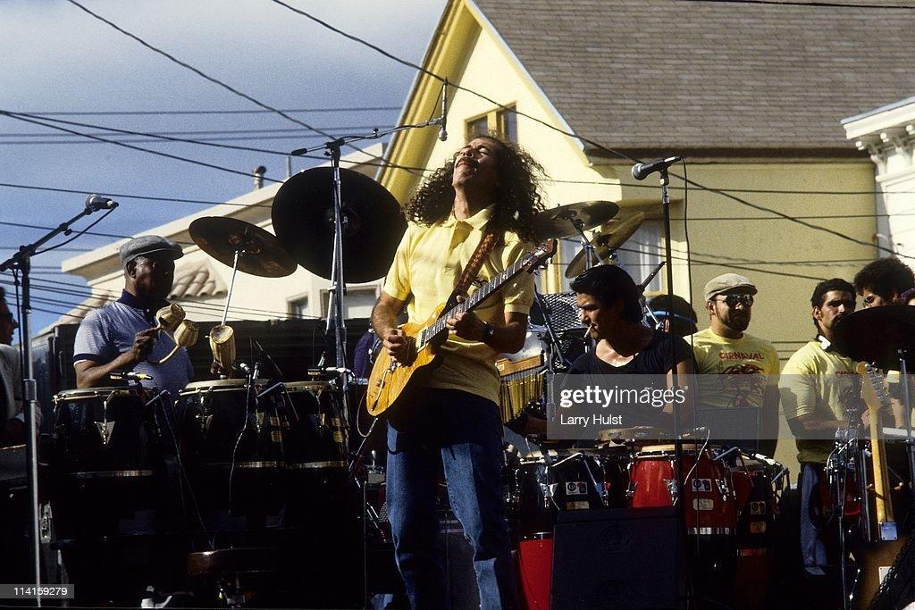 Armando Peraza Carlos Santana Raul Rekow performing with 'Santana' in the Mission District in San Francisco California on May 5 1988