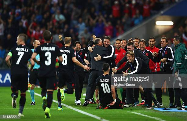 Armando Sadiku of Albania celebrates scoring his team's first goal with his team mates during the UEFA EURO 2016 Group A match between Romania and...