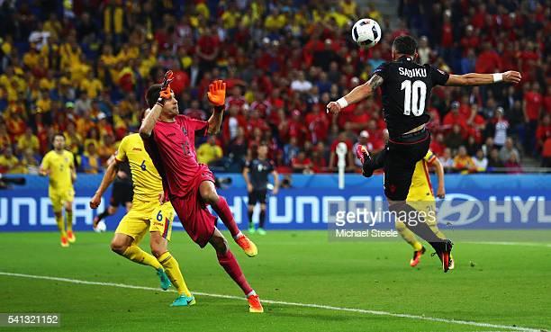 Armando Sadiku of Albania heads the ball to score the opening goal past Ciprian Tatarusanu of Romania during the UEFA EURO 2016 Group A match between...