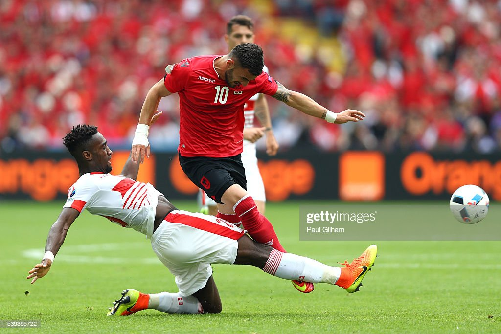 Armando Sadiku of Albania is challenged by Johan Djourou during the UEFA EURO 2016 Group A match between Albania and Switzerland at Stade Bollaert-Delelis on June 11, 2016 in Lens, France.