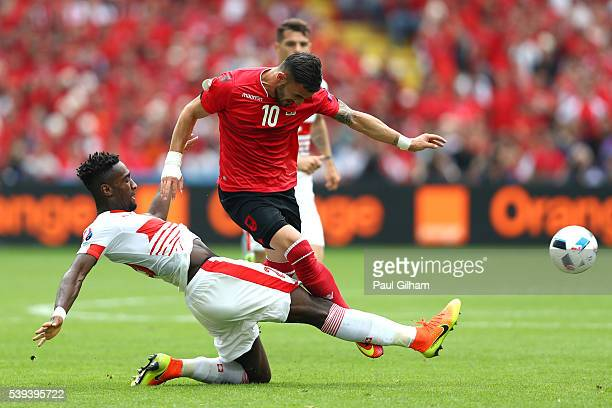 Armando Sadiku of Albania is challenged by Johan Djourou during the UEFA EURO 2016 Group A match between Albania and Switzerland at Stade...