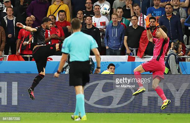Armando Sadiku of Albania scores the opening goal during the UEFA EURO 2016 Group A match between Romania and Albania at Stade des Lumieres on June...