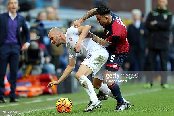 Armandro Izzo of Genoa CFC battles for the ball with Borja Valero of ACF Fiorentina during the Serie A match between Genoa CFC and ACF Fiorentina at...