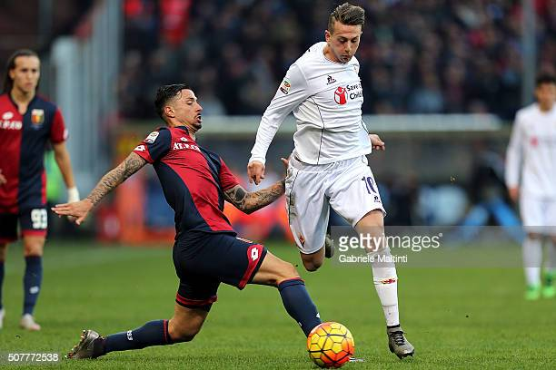 Armandro Izzo of Genoa CFC battles for the ball with Federico Bernardeschi of ACF Fiorentina during the Serie A match between Genoa CFC and ACF...