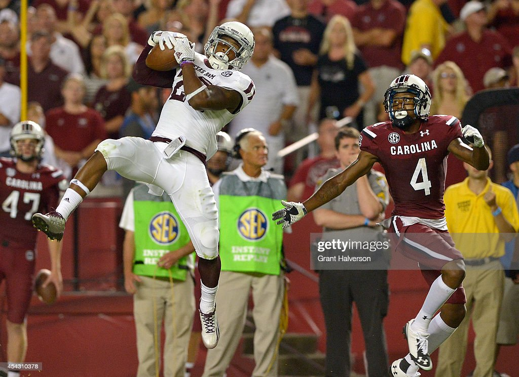 Armani Watts #23 of the Texas A&M Aggies intercepts a pass intended for Shaq Roland #4 of the South Carolina Gamecocks during their game at Williams-Brice Stadium on August 28, 2014 in Columbia, South Carolina. Texas A&M won 52-28.