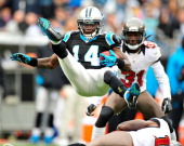 Armanti Edwards of the Carolina Panthers is upended by Arrelious Benn of the Tampa Bay Buccaneers on a kickoff return during play at Bank of America...