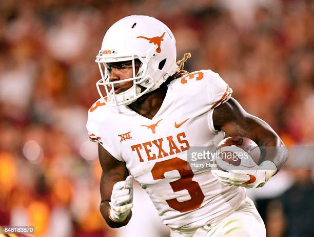 Armanti Foreman of the Texas Longhorns carries the ball during the fourth quarter against the USC Trojans at Los Angeles Memorial Coliseum on...