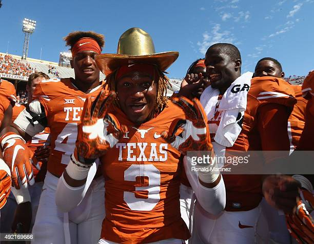 Armanti Foreman of the Texas Longhorns celebrates with the Golden Hat trophy after a 2417 win against the Oklahoma Sooners during the 2015 ATT Red...