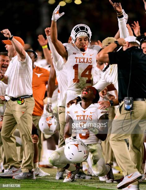 Armanti Foreman of the Texas Longhorns reacts with Lorenzo Joe after a video review confirming his touchdown for a 1714 lead over the USC Trojans...