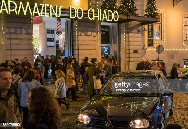Armazens do Chiado Shopping Center Christmas and New Year light displays are reflected on a car parked at the end of Rua Garrett on December 9 2017...