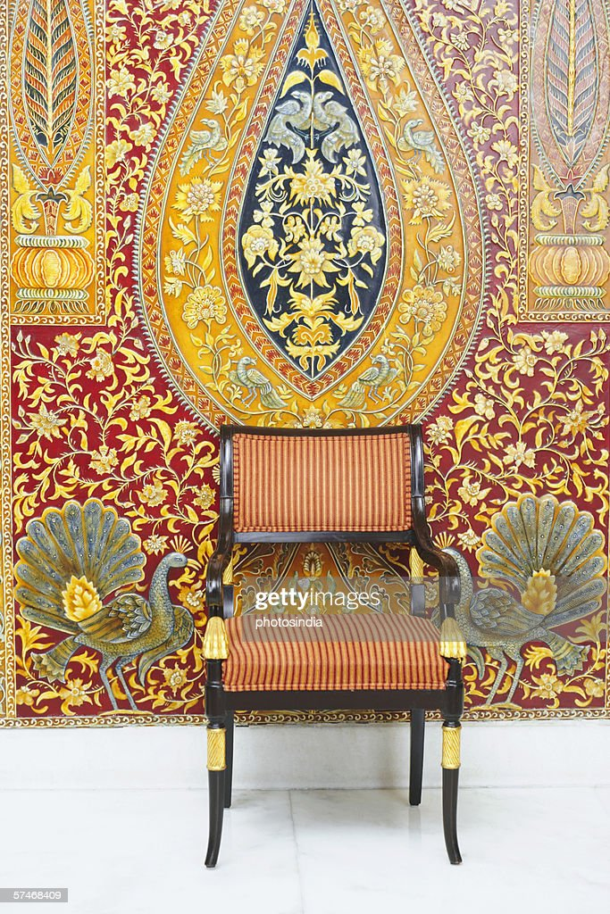 Armchair in front of a wall