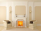 Classic interior in beige tones, the central part of which has a fireplace