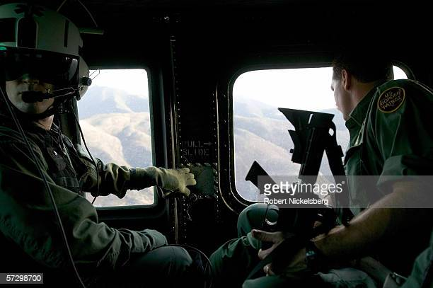 Armed agents from Customs and Border Patrol are about to be dropped from a helicopter for a interdiction operation to intercept Mexican nationals and...