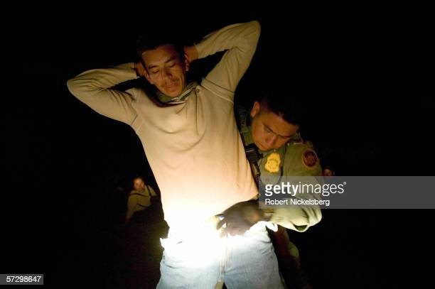 Armed agents from Customs and Border Patrol dropped from a helicopter for a night time interdiction operation intercept 8 Mexican nationals who...