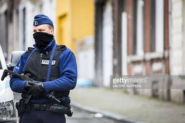 A armed Belgian police officer patrols Colline Street in Verviers eastern Belgium on January 16 one day after two suspected jihadists were killed in...