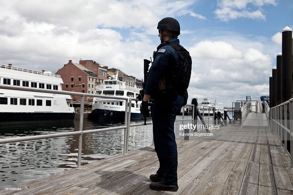 Armed Boston Maritime Safety Security team members patrol the Boston Harbor on April 19, 2013 in Boston, Massachusetts. After a car chase and shoot out with police, one suspect in the Boston Marathon bombing, Tamerlan Tsarnaev, 26, was shot and killed by police early morning April 19, and a manhunt is underway for his brother and second suspect, 19-year-old Dzhokhar A. Tsarnaev. The two men are suspects in the bombings at the Boston Marathon on April 15, that killed three people and wounded at least 170.