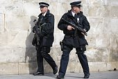 Armed British police officers patrol outside St Paul's Cathedral in London on March 13 ahead of a memorial service to mark the end of Britain's...