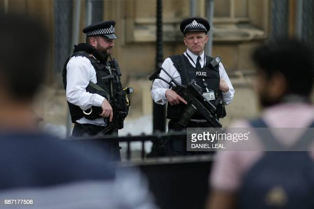 Armed British Police officers stand on duty outside of the Houses of Parliament in Westminster central London on May 23 following the terror attack...