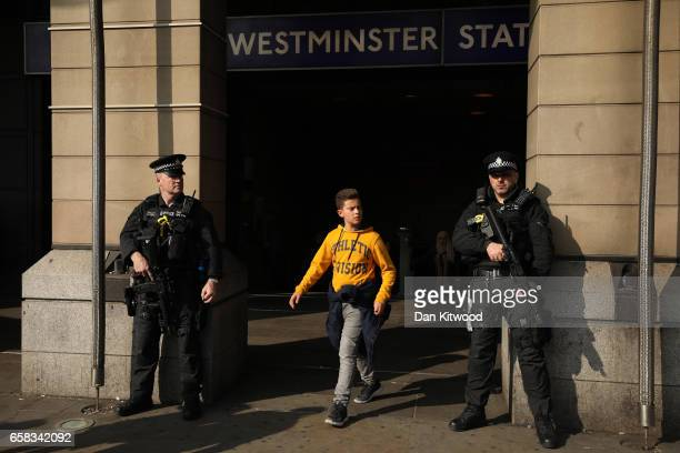 Armed British Transport Police stand outside Westminster Underground Station as tourists exit on March 27 2017 in London England Security has been...