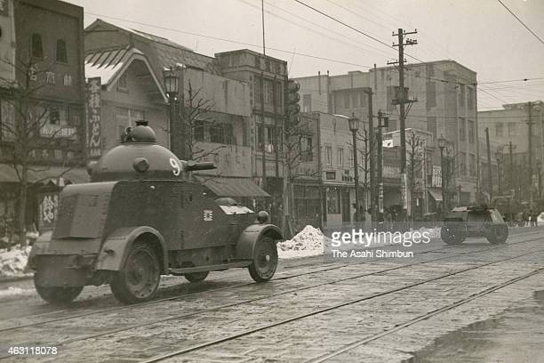 Armed cars of the Imperial Japanese Navy Land Force run toward the Navy Ministry during the February 26 Incident on February 26 1936 in Tokyo Japan