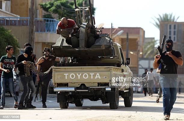 Armed civilians gather in the street during clashes with Islamist militiamen in the alLithi area of Libya's eastern coastal city of Benghazi on...
