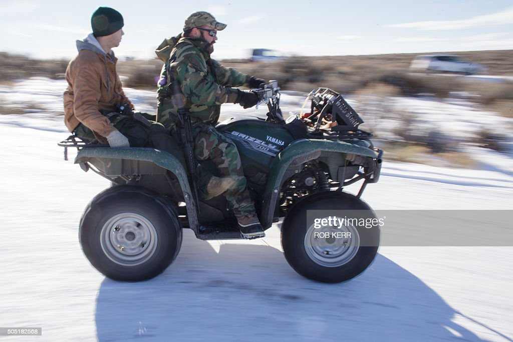 Armed federal building occupiers Corey Lequieu and Geoff Stank both with AR15 rifles ride a four wheeler at the Malheur National Wildlife Refuge...