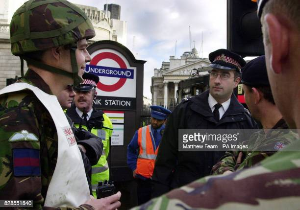 Armed forces firefighters from the Household Cavalry and Police Officers attend a reported incident at Bank underground station in the City of London...