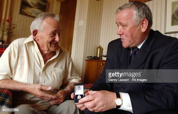 Armed Forces Minister Adam Ingram visits the home of Ronald Cameron to present him with a Veterans' Day badge