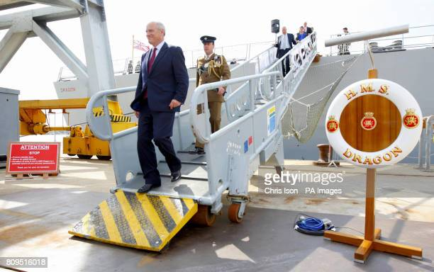 Armed Forces' Minister Nick Harvey MP disembarks the Royal Navy's newest warship the Type 45 Destroyer HMS Dragon as she is handed over to the Royal...