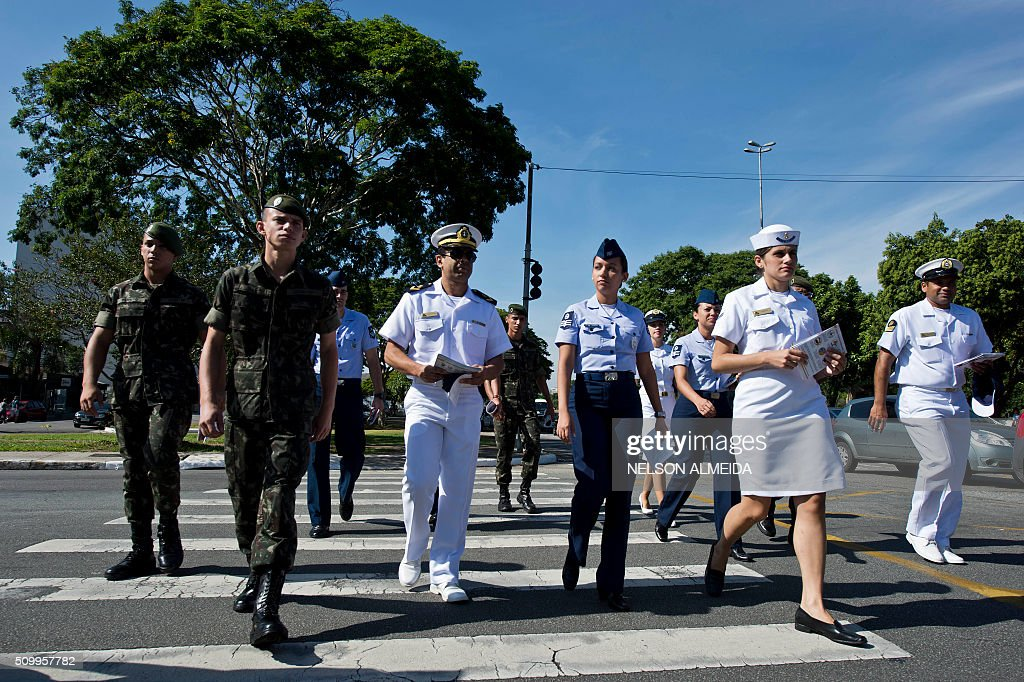 Armed forces personnel get ready to hand out flyers during an awareness campaign on the day of national mobilization against the Aedes aegypti mosquito that transmits dengue and chikungunya fever and zika virus, in Sao Paulo, Brazil on February 13, 2016. Some 220,000 members of the armed forces have been deployed to visit 3 million homes throughout Brazil during the day. AFP PHOTO / Nelson ALMEIDA / AFP / NELSON ALMEIDA