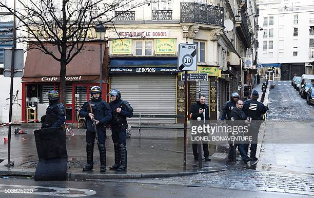 Armed French police patrol near the Boulevard de Barbes in the north of Paris on January 7 after police shot a man dead as he was trying to enter a...