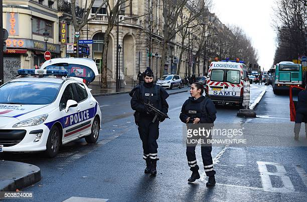 Armed French police women are seen at BarbesRochechouart in the north of Paris on January 7 after police shot a man dead as he was trying to enter a...