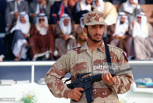 Armed guard soldier in camouflage uniform on duty in front of VIPs in Abu Dhabi